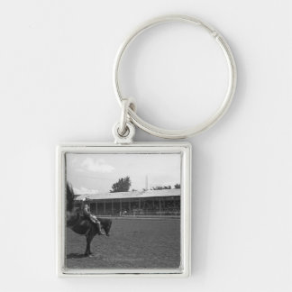 Cowboy riding horse in rodeo, (B&W) Key Ring