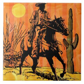 Cowboy riding horseback in desert tile
