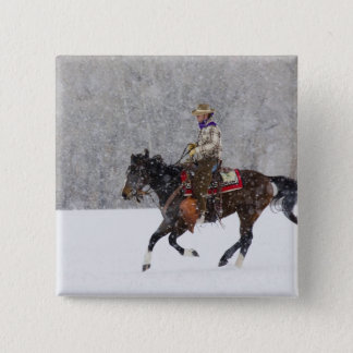 Cowboy riding in snowfall 15 cm square badge