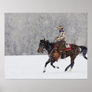 Cowboy riding in snowfall poster