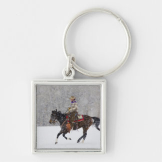 Cowboy riding in snowfall Silver-Colored square key ring