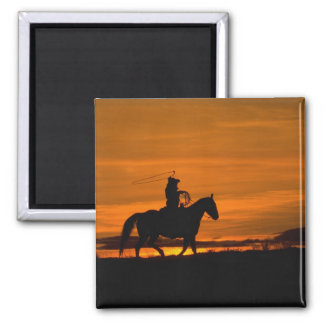 Cowboy riding in the Sunset with lariat Rope Magnet