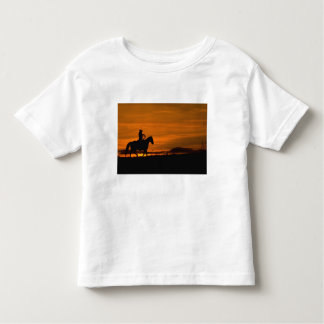 Cowboy riding in the Sunset with lariat Rope Toddler T-Shirt