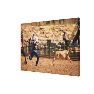 Cowboy roping calf in rodeo canvas print