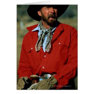 Cowboy sitting on horse wearing red shirt, greeting card