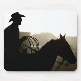 Cowboy with horse at rodeo mouse pad