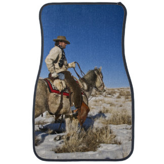 Cowboy with horses on the range on The Hideout Car Mat