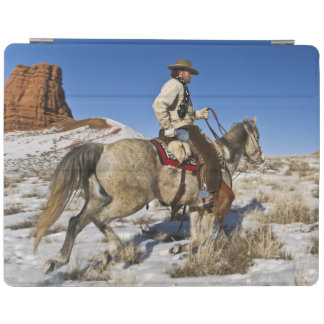 Cowboy with horses on the range on The Hideout iPad Cover