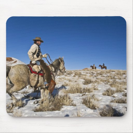 Cowboy with horses on the range on The Hideout Mousepads