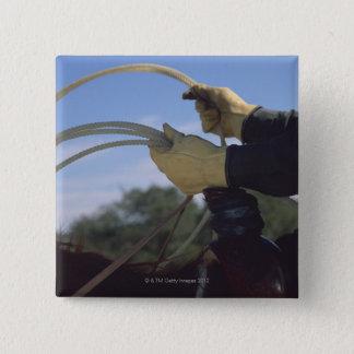 Cowboy's hands with lasso 15 cm square badge