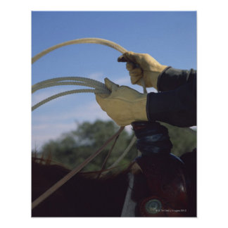 Cowboy's hands with lasso print