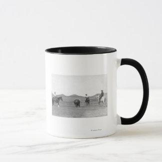 Cowboys on Horses Roping Buffalo Photograph Mug
