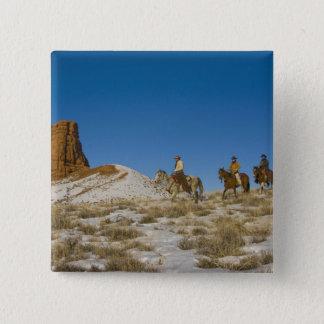 Cowboys on Ridge riding Horse through the Snow 15 Cm Square Badge