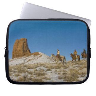Cowboys on Ridge riding Horse through the Snow Laptop Sleeve