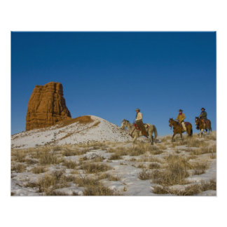 Cowboys on Ridge riding Horse through the Snow Poster