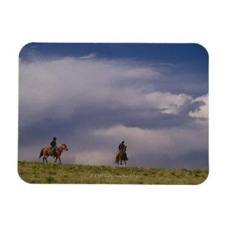 Cowboys riding horses rectangular photo magnet