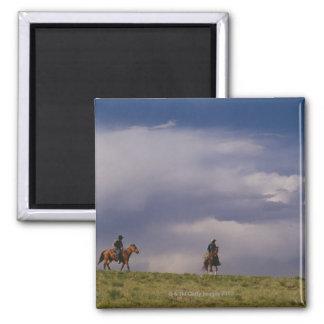 Cowboys riding horses square magnet