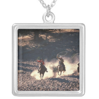 Cowboys riding silver plated necklace