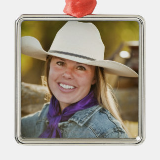 Cowgirl beside fence Silver-Colored square decoration