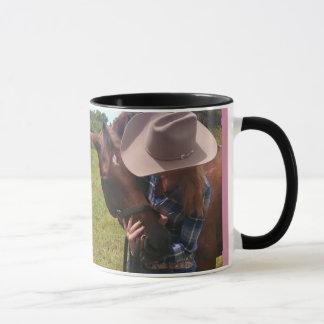 Cowgirl loving on barrel horse mug