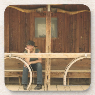 Cowgirl sitting on ranch porch coaster