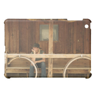 Cowgirl sitting on ranch porch cover for the iPad mini