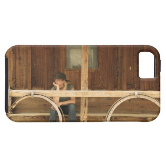 Cowgirl sitting on ranch porch iPhone 5 case