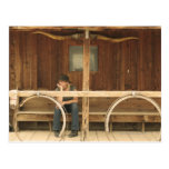 Cowgirl sitting on ranch porch post cards