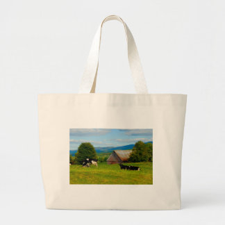 Cows in a field large tote bag