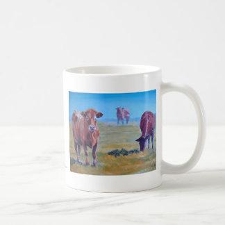 Cows painting coffee mugs