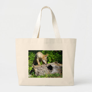 Coyote Pup - What is in that Log? Tote Bag