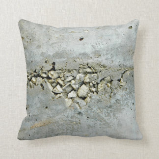 Cracked concrete wall with small stones cushion