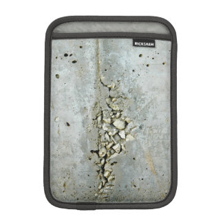Cracked concrete wall with small stones iPad mini sleeve