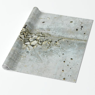 Cracked concrete wall with small stones wrapping paper