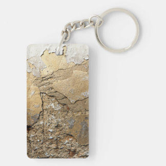 Cracked plastered wall. key ring