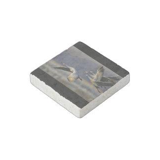 cranes in flight stone magnet
