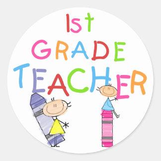 Crayons 1st Grade Teacher Tshirts and Gifts Round Sticker