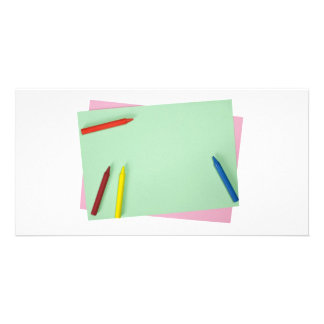Crayons on colored papers photo greeting card