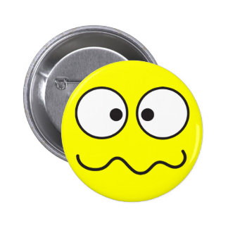 Crazy insane smiley face cross eyed 6 cm round badge