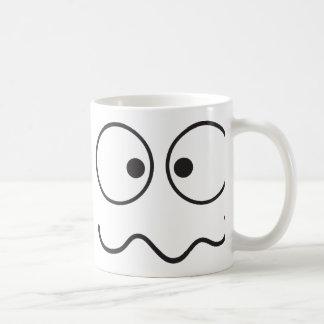 Crazy insane smiley face cross eyed coffee mug