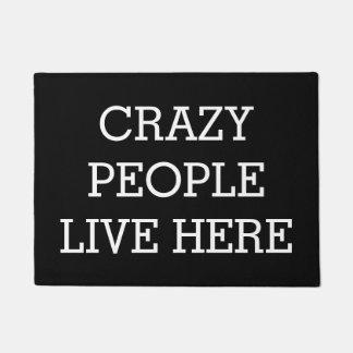 Crazy People Live Here Black Funny Doormat