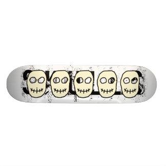 Cream and Black Skull. Primitive. Skateboard Deck