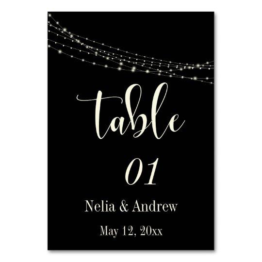 Cream Typography 30 on Black w Lights Table