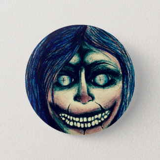Creepy clown doll grinning face badge