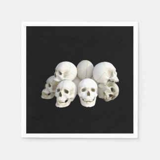Creepy pile of skulls black disposable serviette