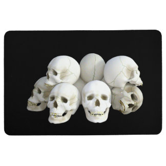 Creepy pile of skulls black floor mat