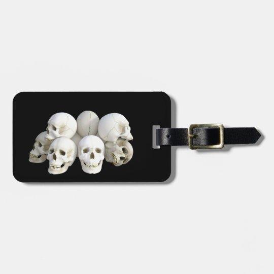 Creepy skulls pile luggage tag
