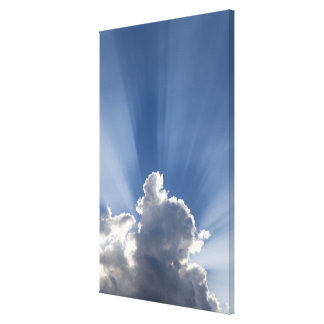 Crepuscular or God's rays streak past cloud. Gallery Wrapped Canvas