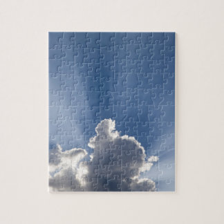 Crepuscular or God's rays streak past cloud. Jigsaw Puzzle