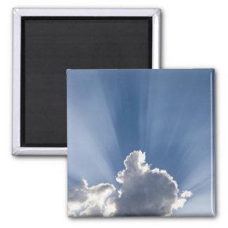 Crepuscular or God's rays streak past cloud. Magnet